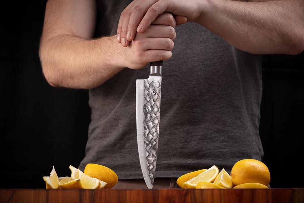 BARE Knife with lemons on cutting board
