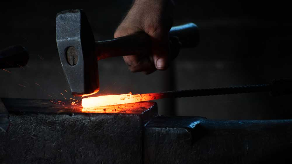 Forging steel on anvil